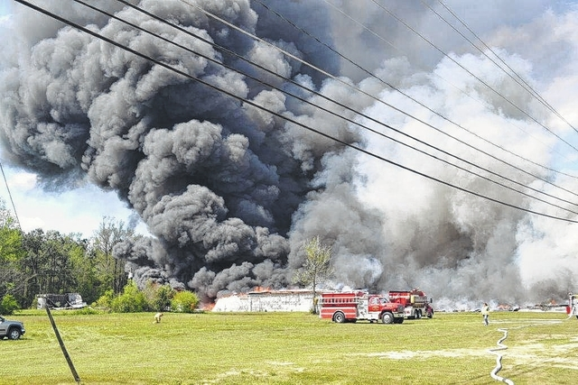 Courtesy photo by Brian Duckworth Heavy smoke from a fire at a former tobacco warehouse in Fairmont was visible from miles away Wednesday afternoon, as firefighters from as many as 15 departments battled the blaze.