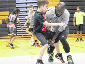 Johnson, Braves help develop youth wrestlers of all ages and sizes at UNCP camp