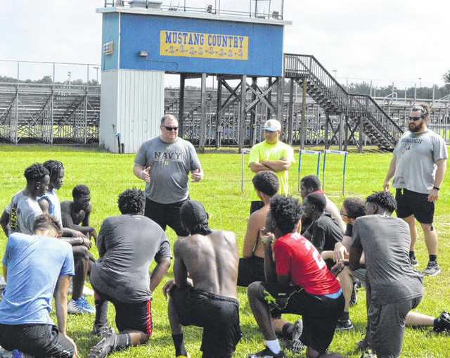 Back in action: South Robeson football returns to workouts after announcement