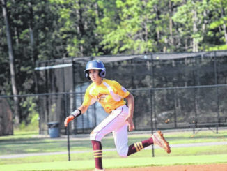 Lumberton Dixie splits at state tournament