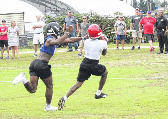 Red Devils learning to conquer adversity at 7-on-7 with bigger schools
