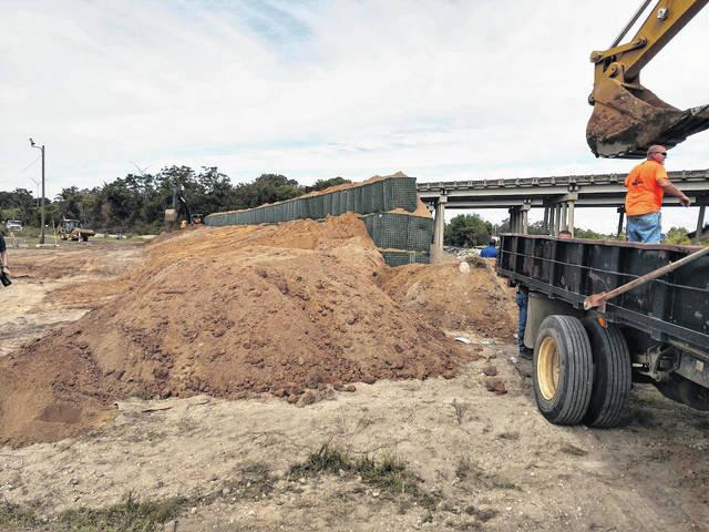 City constructing berm at CSX railroad opening