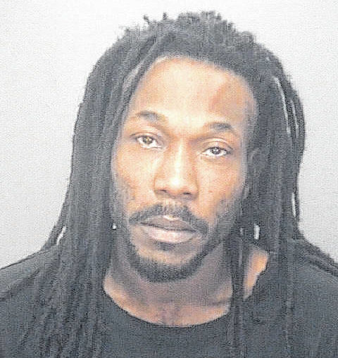Man charged with firing at police officers