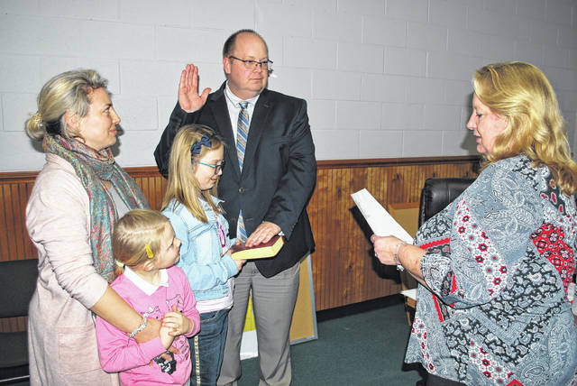 John Gudauskas, Jr. was sworn in Thursday by Town Clerk Debra McNeill during a St. Pauls Board of Commissioners meeting to serve the remaining two years of the District 1 seat left vacant by Mayor Elbert Gibson. His wife, Anna, left, and daughters Olivia, front, and Emily watch the ceremony.
