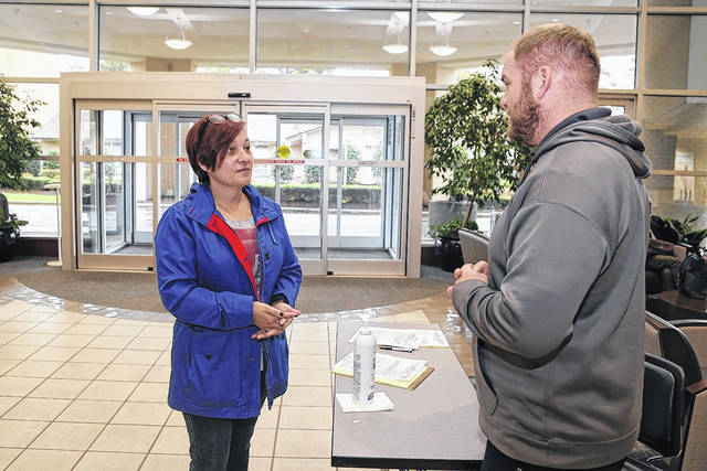 Athletic trainers step up to screen visitors at Southeastern Regional Medical Center