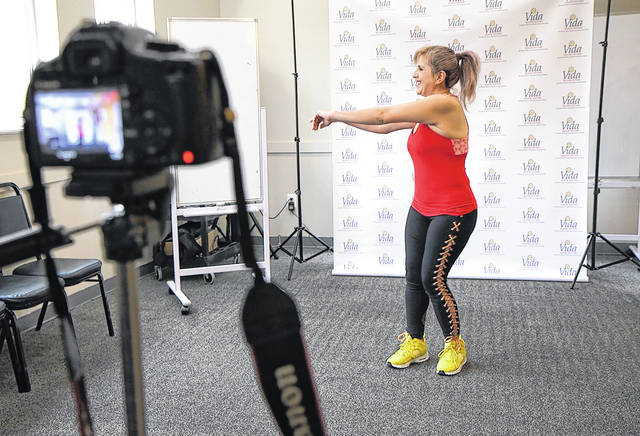 In this March 17 photo, dance instructor Lola Jaramillo records a Zumba and exercise lesson in Washington, D.C., that will be uploaded in the social media accounts of Vida Senior Center, a nonprofit that serves Washington's older Hispanic community.