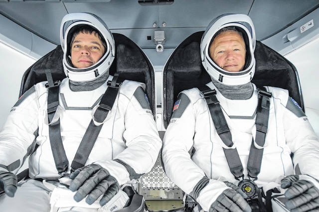 <p>NASA astronauts Bob Behnken, left, and Doug Hurley will be the first humans to fly a commercial spacecraft when they launch Wednesday on SpaceX's Crew Dragon capsule from Kennedy Space Center pad 39A. It will also mark the first time astronauts have launched from U.S. soil since the shuttle program ended in 2011.</p>                                  <p>Courtesy photo</p>