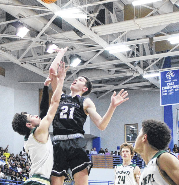 <p>Jonathan Bym | The Robesonian</p>                                 <p>Matt Locklear takes a runner in the paint over a Pinecrest defender in the NCHSAA 4A East Regional final in March. The Pirates won the game to earn a berth in the state championship game. Because the game was canceled, the 2020 Lumberton boys were named state co-champions, the school's first state title since 2001. Locklear's older sister, Cheryl, was a part of that team.</p>