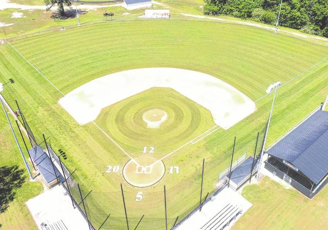 Fairmont honors baseball and softball seniors by painting their numbers on the fields