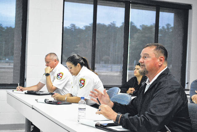 Robeson County Sheriff Burnis Wilkins speaks Wednesday during a meeting at Robeson Community College attended by local health and law enforcement officials who discussed developing a program that will decrease deaths by overdose and provide treatment to drug addicts.