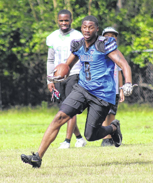 <p>Jonathan Bym | The Robesonian</p>                                 <p>Eric Graham returns an interception on Sunday's 7-on-7 scrimmage for the Robeson County Bears.</p>
