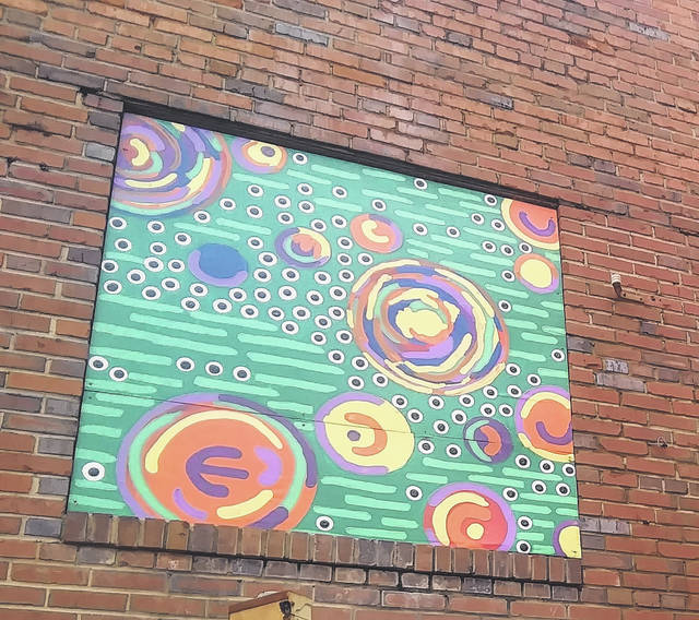 <p>Tomeka Sinclair   The Robesonian</p>                                 <p>Shown is one of the painted wooden panels that now covers an old boarded window in a Lumberton downtown alleyway. The abstract work is by Scotty Thompson, an art teacher at Lumberton High School.</p>
