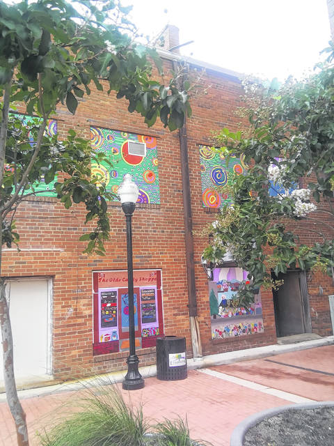 <p>Tomeka Sinclair   The Robesonian</p>                                 <p>Some Public Schools of Robeson County art students and teachers have loaned their talent to help spruce up an alley in downtown Lumberton. Artworks can now be seen covering some of the old, boarded windows between Elm and Chestnut streets.</p>