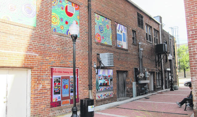 Courtesy photo   Scott Biglow                                 Some Public Schools of Robeson County art students and teachers have loaned their talent to help spruce up an alley in downtown Lumberton. Artworks can now be seen covering some of the old, boarded windows between Elm and Chestnut streets.