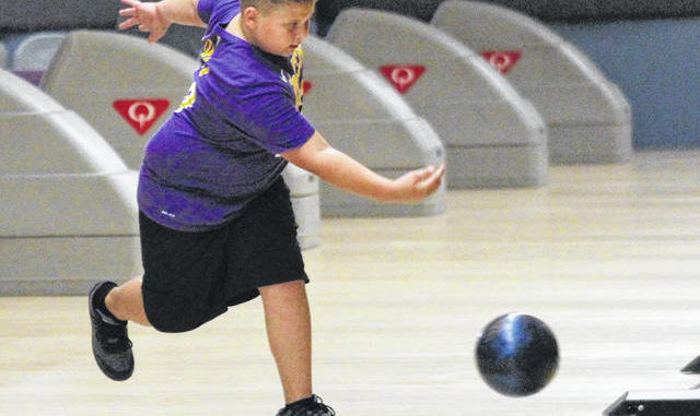 Jonathan Bym | The Robesonian                                 Connor Zindros sends a bowling ball down a lane at the Lumberton Bowling Center on Friday. Bowling alleys across the state reopened this week thanks to a state judge's injunction, bringing bowlers of all ages back to the bowling center on Godwin Avenue.