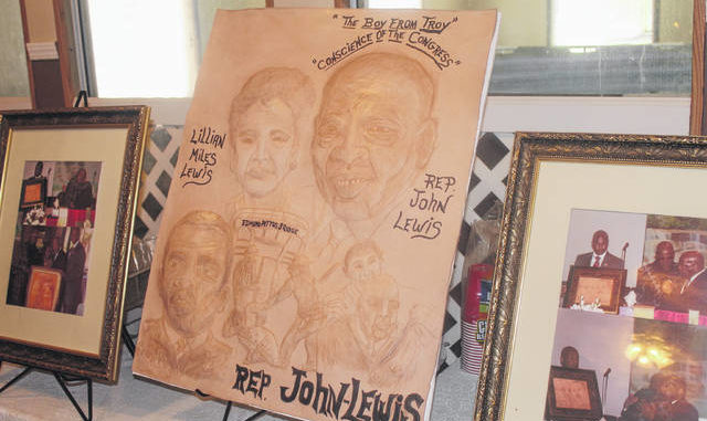 Red Springs leather artist Terrence Hill is in the process of completing two works featuring civil right activist and U.S. Congressman John Lewis and George Floyd, a man whose death triggered a national outcry for justice among those who are victims of police brutality.
