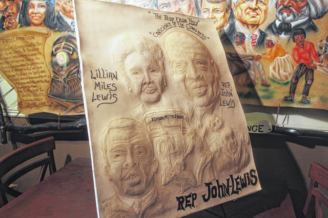 """<p>Here is a leather artwork by artist Terrence Hill that features the late U.S. Congressman John Lewis. The piece includes an image of the Edmund Pettus Bridge, and also depicts Lewis being beat by Alabama state troopers on what is known historically as """"Bloody Sunday.""""</p>"""