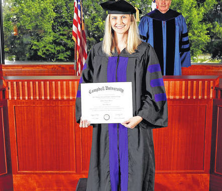 Lumberton's Callie Elaine Davis participated in a private hooding ceremony after receiving her Juris Doctor degree at Campbell University's Norman Adrian Wiggins School of Law. Shown is Davis with the Dean of Law J. Rich Leonard.                                  Courtesy photo | Campbell University