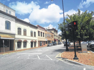 Sidewalks in downtown Lumberton are devoid of pedestrians Friday, two days after Gov. Roy Cooper announced he was extending Phase II restrictions on, among other things, businesses, gyms and mass gatherings.                                  Tomeka Sinclair | The Robesonian