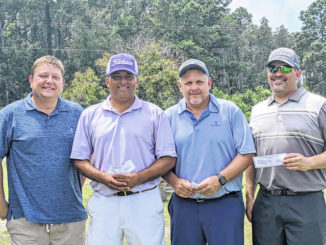 Courtesy photo                                 The winners of the 18th annual John Williamson Golf Tournament pose after finishing up their round. Team members pictured from left to right, Kendall Hamilton, Jamie Locklear, Jonathan Blue and Channing Jones.