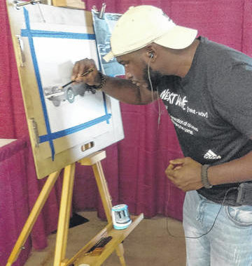 Kendreek Mitchell sketches out details in a drawing of a vintage car. The Rowland resident has produced several commissioned works for people across the United States.