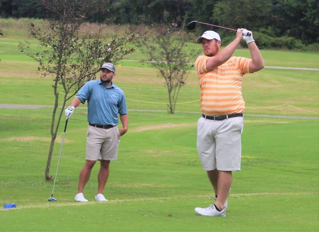 <p>Chris Stiles   The Robesonian</p>                                 <p>Ryan Bass tees off on the 13th hole in the second round of the Robeson County Golf Championship Saturday at Pinecrest Country Club.</p>