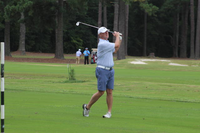 <p>Chris Stiles   The Robesonian</p>                                 <p>Scott Benton hits his approach on the 16th hole in the second round of the Robeson County Golf Championship Saturday at Pinecrest Country Club.</p>