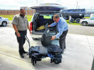 Students in law enforcement training receive body armor