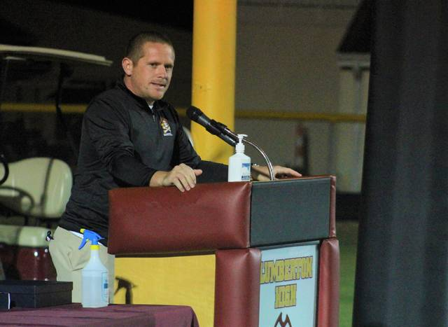<p>Chris Stiles | The Robesonian</p>                                 <p>Lumberton boys basketball coach Bryant Edwards gives his remarks during the ring ceremony for the Pirates' boys basketball team Monday at Alton G. Brooks Stadium.</p>