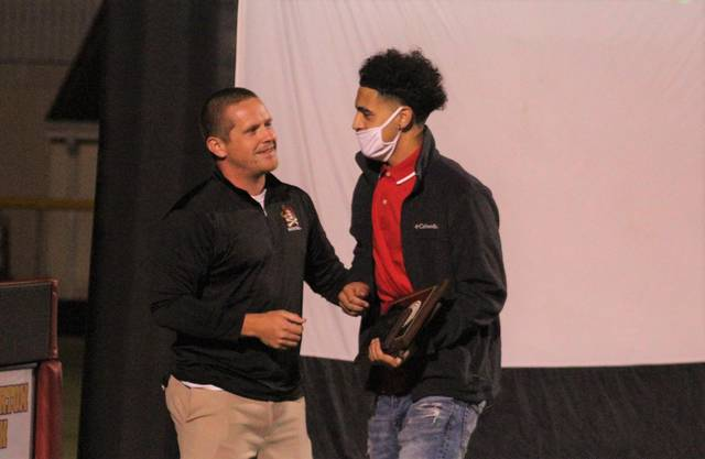 <p>Chris Stiles | The Robesonian</p>                                 <p>Lumberton boys basketball coach Bryant Edwards gives Jordan McNeill a pat on the back after giving him the team's Most Valuable Player award for the 2019-20 season at the Pirates' ring ceremony Monday at Alton G. Brooks Stadium.</p>