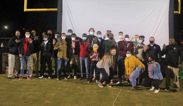 <p>Chris Stiles | The Robesonian</p>                                 <p>Members of the Lumberton boys basketball team take a group photo after the team's ring ceremony Monday at Alton G. Brooks Stadium.</p>