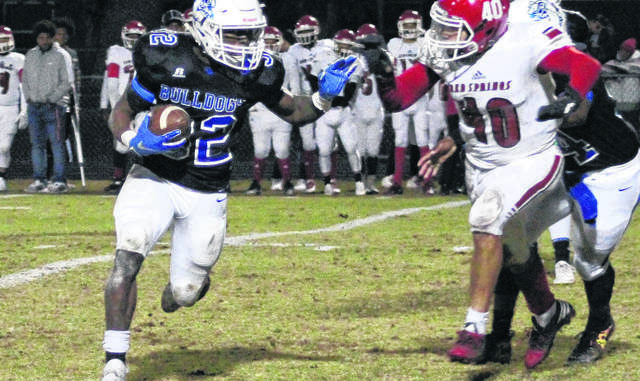 The Robesonian file photo                                 St. Pauls running back Marqueise Coleman looks to turn the corner against Red Springs' Daylon Hall during a 2019 game between the schools in St. Pauls. Coleman was named the Robeson County Heisman after the season.