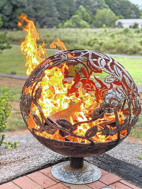 <p>Shown is custom fire pit by metal artist Chaz Lamb. The Lumberton artist is the owner of C Lamb Creations.</p>                                  <p>Courtesy photo</p>
