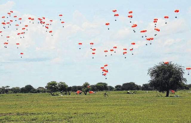 <p>Courtesy photo | U.N. World Food Program</p>                                 <p>Food falls to the ground in Africa after the U.N. world Food Program made the drops from planes using parachutes designed by Steven Singletary. Singletary is a professor at The University of North Carolina at Pembroke.</p>                                  <p>Courtesy photo | U.N. World Food Program</p>