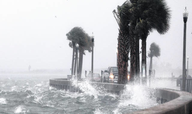 Water splashes Wednesday against the seawall along Pass A Grille Way in St. Pete Beach, Florida, as squalls from Tropical Storm Eta move through Pinellas County. Eta has weakened to a tropical storm just hours after regaining hurricane strength as Florida braces for a second hit from the storm.                                  Scott Keeler | Tampa Bay Times via AP