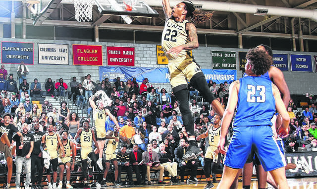 UNCP Athletics                                 Former UNCP forward Shaun Kirk flies through the air for a one-handed slam during the Braves' game against North Georgia in March in Pembroke. Kirk was drafted by the Harlem Globetrotters Monday and has interest in joining the team.