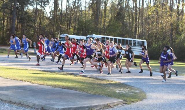 Chris Stiles | The Robesonian                                 Runners from Red Springs, St. Pauls and West Bladen start Friday's 5K race at Red Springs.