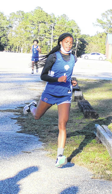 <p>Chris Stiles | The Robesonian</p>                                 <p>St. Pauls' Jakieya Thompson approaches the finish line to win Friday's cross country race at Red Springs.</p>