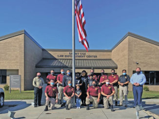Cadets of the Fall 2020 Robeson Community College Basic Law Enforcement Training Academy selected Deputy Patrick Locklear, fourth from left, for this year's Thanksgiving Family Adoption.