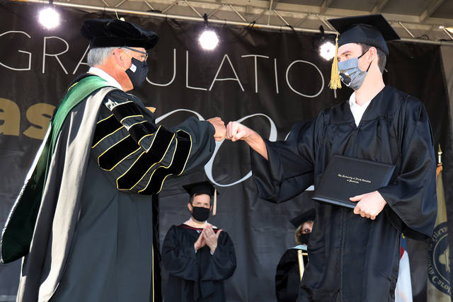 UNCP graduates urged to change the world