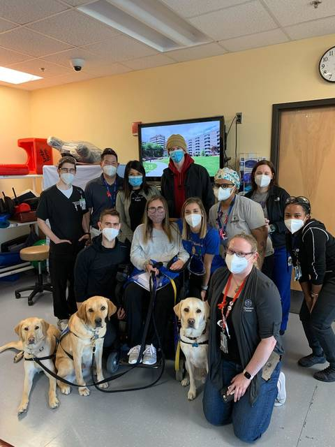 <p>Courtesy photo</p>                                 <p>Brooke Humphrey is shown with the group of medical professionals at Shepherd Center in Atlanta during her graduation from the inpatient program. She returned to her Saddletree home Tuesday after a three-month stay at the Center.</p>