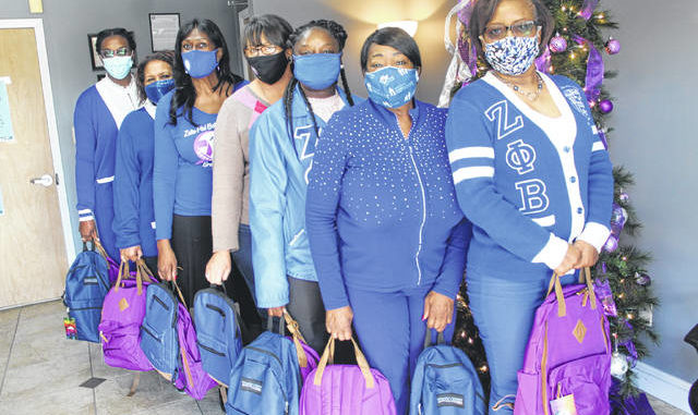 The Zeta Phi Beta Sorority, Inc., Lambda Eta Zeta Chapter of Lumberton recently donated 50 backpacks filled with supplies, including a journal and toiletries, to the Southeastern Family Violence Center. Shown, from left, are Lambda Eta Zetas Archita Graves, Wixie Stephens and Sharon Scott, Southeastern Family Violence Center Executive Director Emily Locklear, and Zetas Latasha Murray, Dianne Surgeon and Dee Grissett.                                  Tomeka Sinclair   The Robesonian