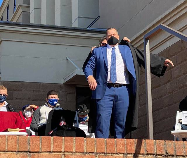 <p>Courtesy photo | Angelica Chavis McIntyre</p>                                 <p>Greg Bullard is robed by his wife, Jessica Bullard, during a swearing-in ceremony held Saturday outside Robeson County Courthouse. Bullard now is the Robeson County's District Court 16B Seat 6 judge.</p>