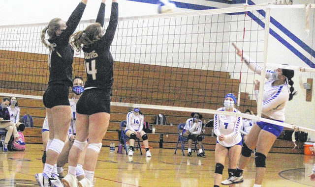 Chris Stiles | The Robesonian                                 Croatan's M.J. Klaumann, 11, and Shelby Waltrip, 14, attempt to block after a spike by St. Pauls' Braxtin Kinlaw, 6, during Tuesday's first round 2A state playoff game in St. Pauls.