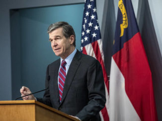 Cooper extends curfew as GOP questions COVID-19 vaccine plan