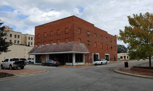 Courtesy photo   Sara Voecks                                 The building that once housed the Kimbrell's Furniture store at Chestnut and Third streets in downtown Lumberton will now be the home of the Inner Peace Center for the Arts, a space that will serve as an art gallery/studio.