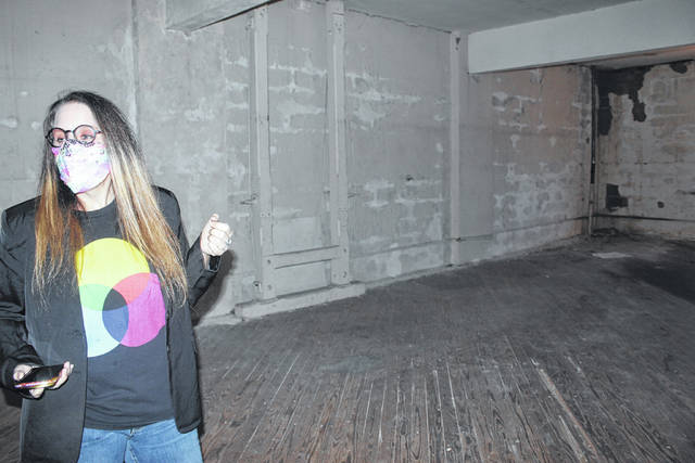 <p>Tomeka Sinclair   The Robesonian</p>                                 <p>Sara Voecks, the Marketing and Arts director for Inner Peace Center for the Arts, shows where a photography studio will be placed at the new location on Chestnut Street in Lumberton.</p>