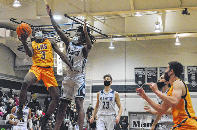 <p>Contributed photo</p>                                 <p>Lumberton's Jadarion Chatman, 3, takes a shot over Millbrook's CeeJay Jordan, 24, during Tuesday's NCHSAA 4A East Regional final in Raleigh.</p>