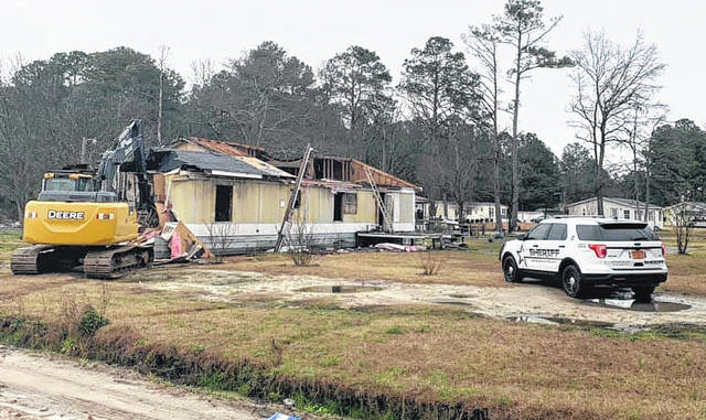 A mobile home on Jefferson Road in Maxton is demolished Wednesday after its owner failed to comply with a court order to move or demolish the structure as the result of a nuisance abatement case involving the Robeson County Sheriff's Office and North Carolina Alcohol Law Enforcement's Nuisance Abatement Team.                                  Courtesy photo   Sheriff Burnis Wilkins