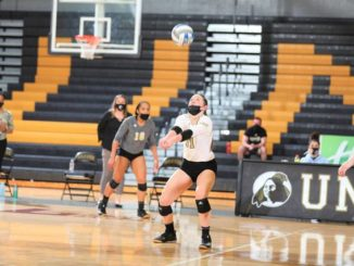 UNCP Athletics                                 UNC Pembroke's Elise Martin (11) sets in front of Kaila Crowder (16) during a match earlier this season.
